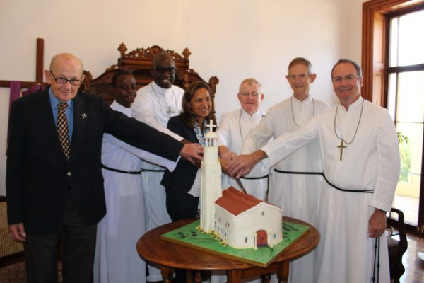 Cutting of the Cake - a replica of the school chapel. From left, Br Mario, Br Peter, Br Fortune, Aeysha Adams, Br Joseph, Br Jude, Br Tony